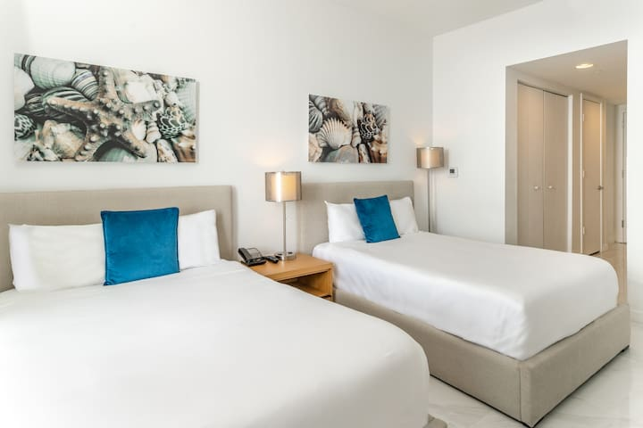 Our luxurious Studio Suite comes with 2 full-size beds and linens. The room and the balcony have marble floors. One of the best Studios at The BeachWalk Resort!