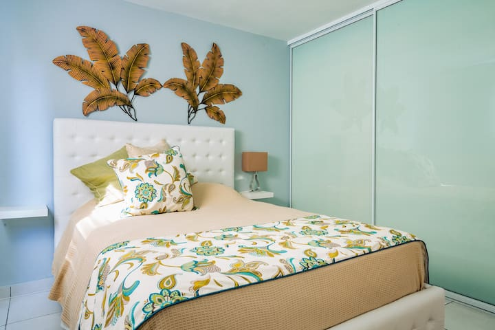 This is guest room to equipped with a queen size mattress that sleeps two comfortably mattress and linens from Peacock Alley are of the highest quality this bedroom has a large closet that fits large suitcases. Room has bath and beach towels for two