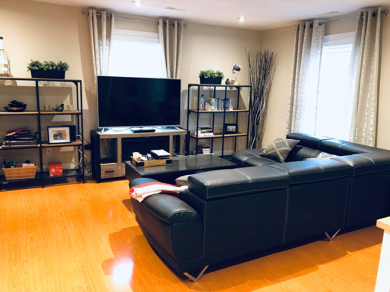 Living Room 1/2 with TV, DVD player & ROKU (access to Netflix as well)