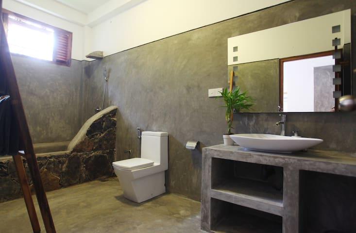 En-suite bathroom with shower and bath tub