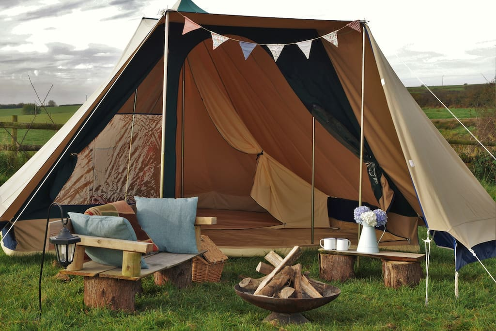 Canvas tent and fire pit provided.