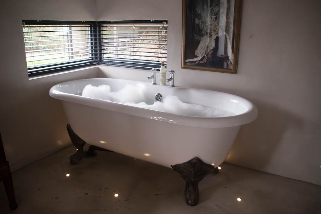 A bath with the Queen looking on, while you enjoy the countryside views from the letterbox window