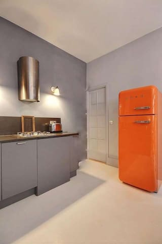 Kitchen   The open kitchen is equipped with : fridge, freezer, dishwasher, gas burner, extractor hood, oven, microwave, washer, dryer, coffee maker, kettle, toaster, and all kitchen utensils, built-in shelves, built-in wall closet, concrete floor.