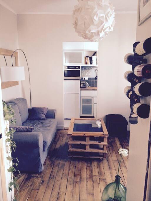 Perspective depuis la chambre du salon et de la cuisine en fond