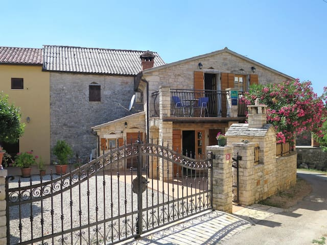 Beautiful stone house Angela with terrace, located in the center of the small village