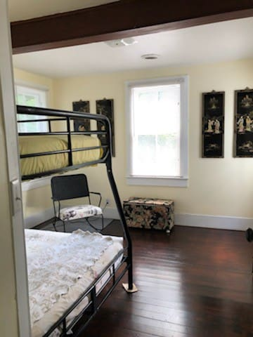BR 2 w bunk beds 1 full size bottom and twin on top.  Great sunshine in this room.