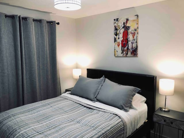 Second bedroom with Queen Platform Bed with Down Pillows.  Two bedside lamps with extra electrical outlet for your iphone charger.
