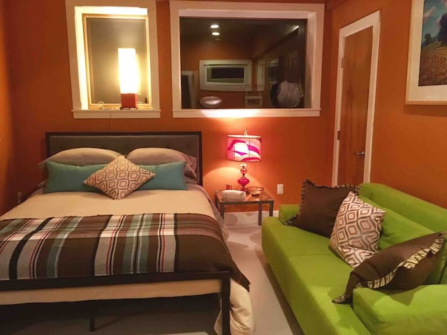 Queen bed and couch in Kiva Suite sleeping alcove