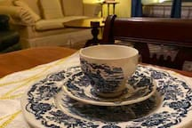 House of Windsor china with living room and bed in background