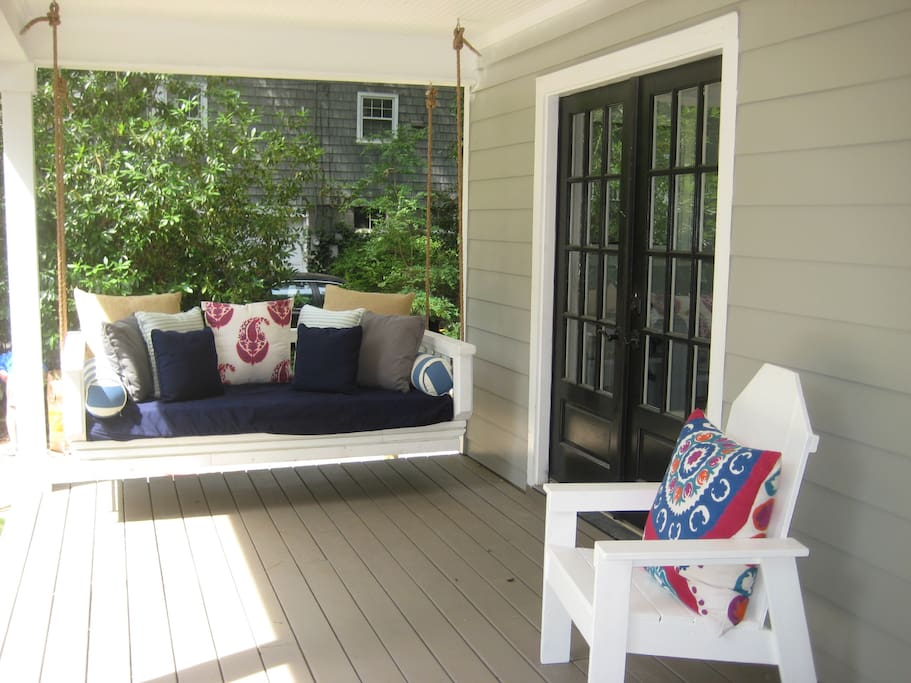 Hanging Daybed Swing. You will love sitting on it and watching all of the families walking by to the park.