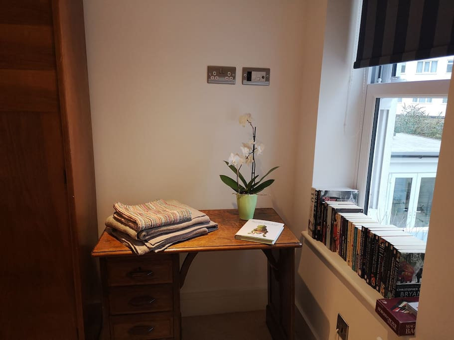 Desk space to work or write your postcodes. Fold up chair provided