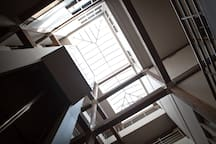 The great atrium inside the Nashville Downtown Hostel offers lots of natural light in a newly renovated former factory building in downtown Nashville!