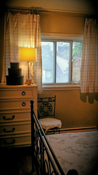 Large window with lovely breeze at night with window fan. (Main living areas are air conditioned.)