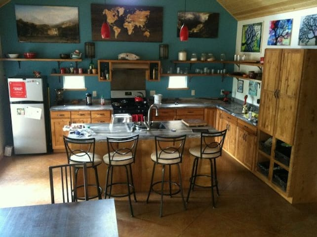 A view into the kitchen. There is a loft overlooking this space.
