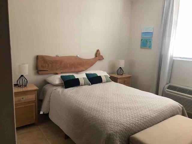 The small bedroom has a double bed and smart television.