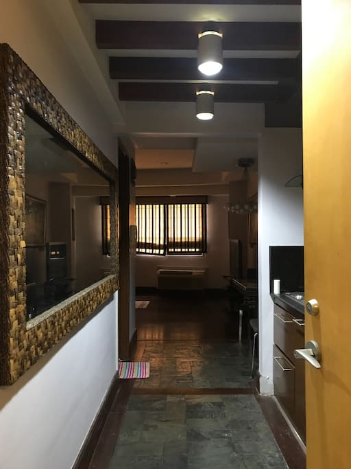 Entrance of unit with modern chic interior