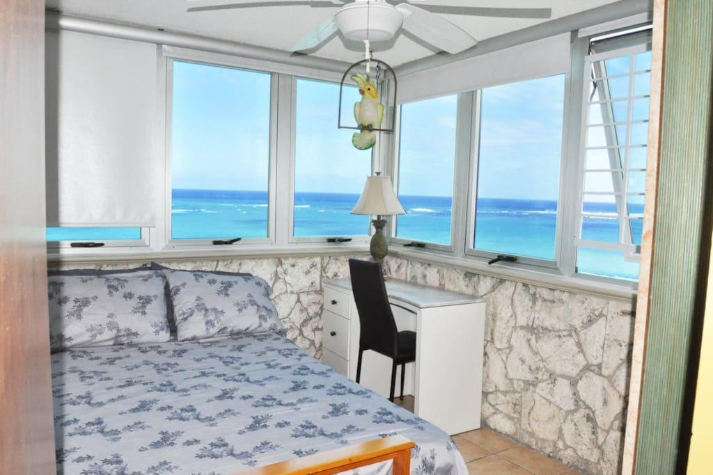 Room with amazing views to the sea and a sofa futon.