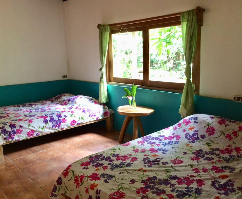 Room Mango with two matrimonial beds
