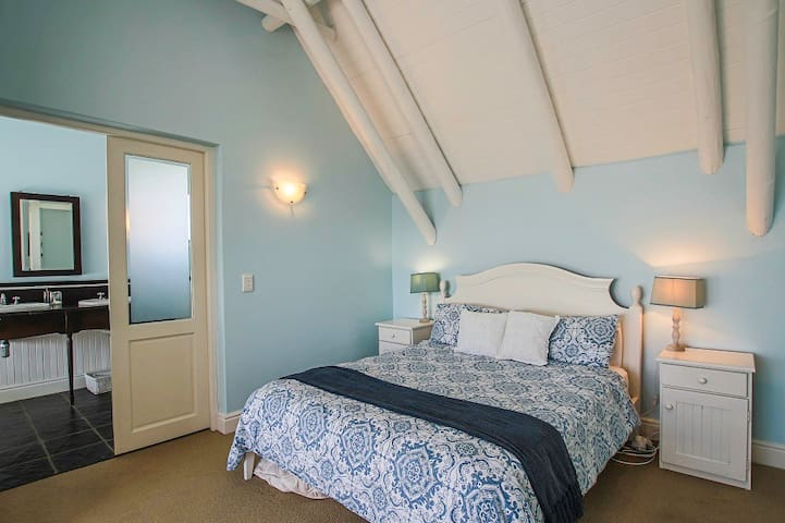 Main bedroom upstairs which is en-suite and has it's own private veranda with views across the ocean and beaches of St Francis Bay.