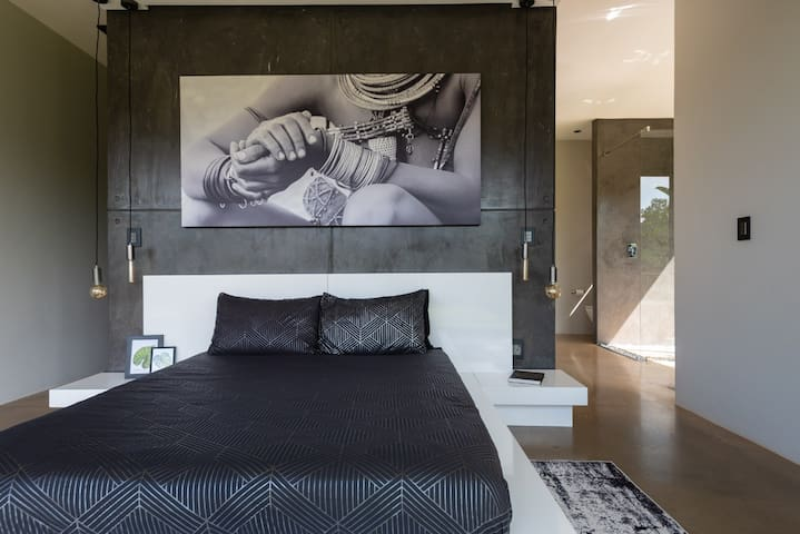 The main bedroom is a delight of minimalist design and functionality. The gorgeaus bathroom and spacious walk-in closet are right behind the comfortable custom-made queen size bed. All beds have waterproof mattress protectors for your convenience.