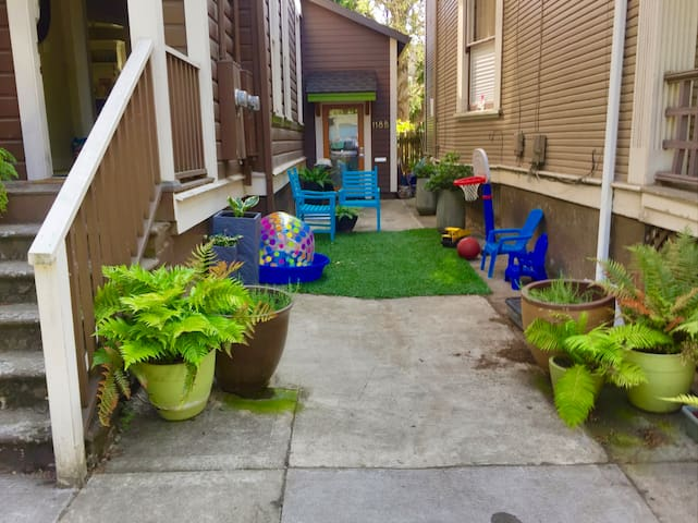 Access your guesthouse through our private alley. We kit it out for summer fun.