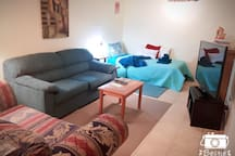 living area with hide-a-bed and love seat and extra single day bed