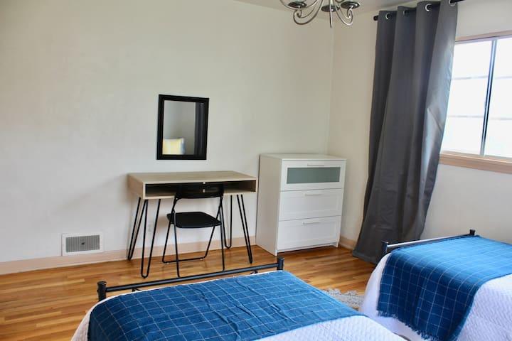 Bedroom 1: two twin beds, dresser & desk