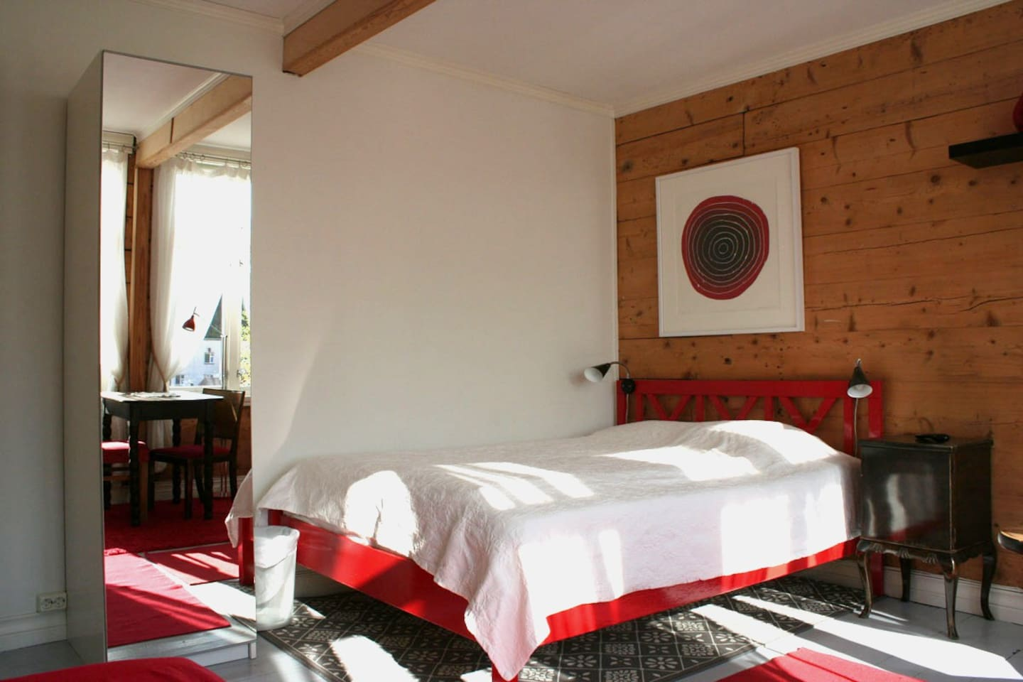 Red room, double bed + one single bed, view to the sea