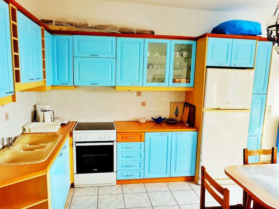 THE KITCHEN IS LARGE ENOUGH AND FULLY EQUIPPED !!!