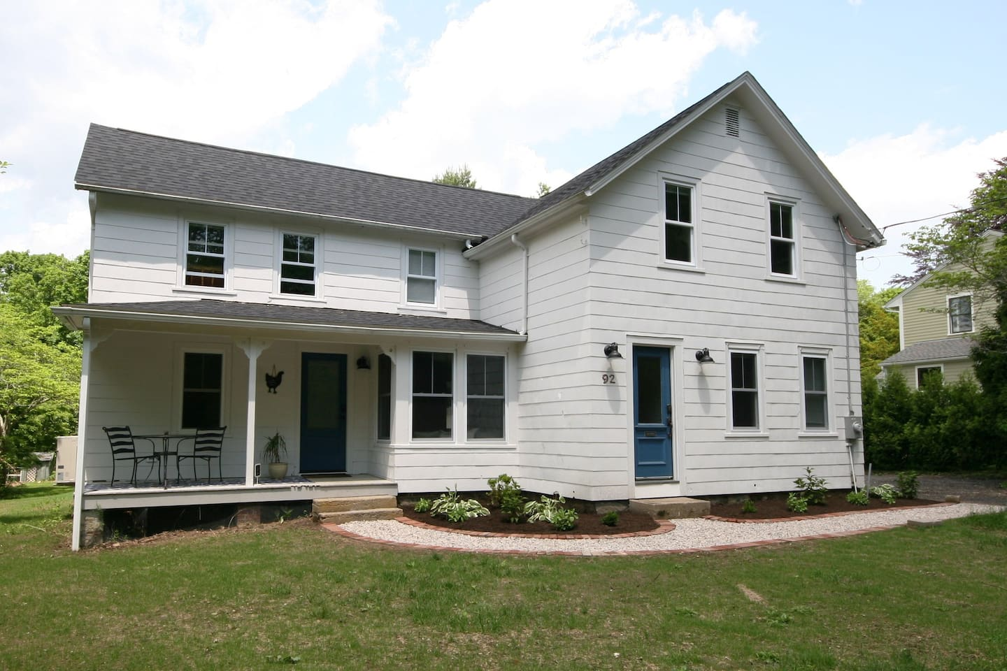 Front view of home. Entry to guest quarters is through covered front porch door