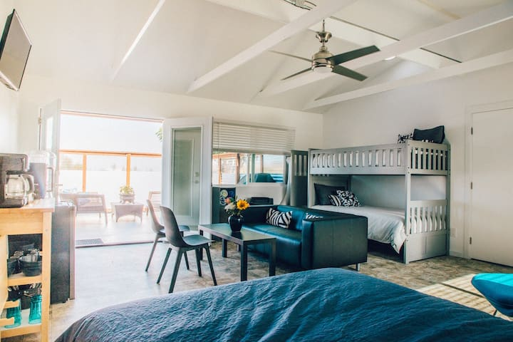 Spacious unit with queen bed, twin custom bunks, kitchenette and seating area