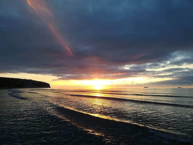 Sunrise in Sandown Bay, from the beach below Fossils Reach.