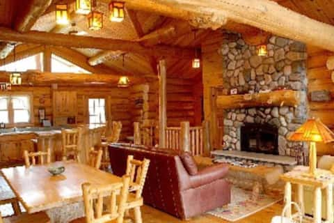 Social distance in this beautiful log lake home.