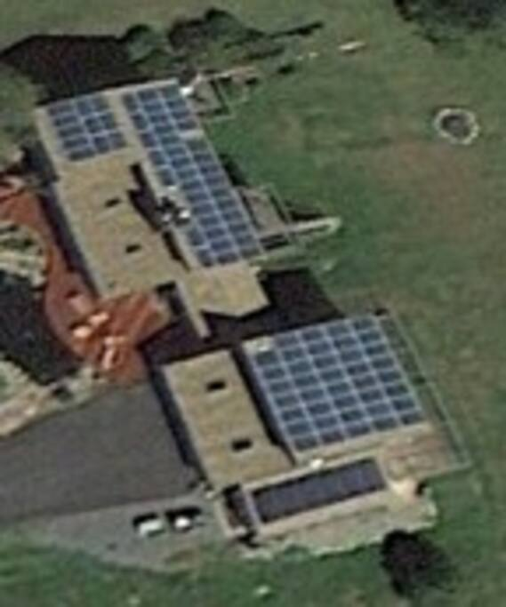 Our house is 100% solar electric.  Here is the view from the Google Earth satellite.