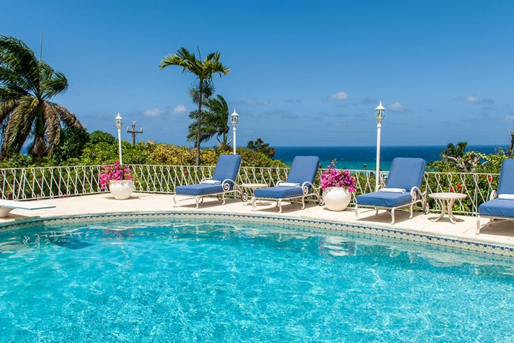 The terrace encircling the heated pool offers guests a stunning blue view over the Caribbean Sea.