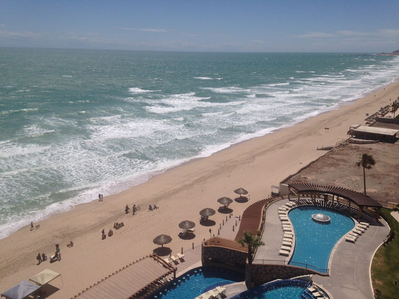 Ocean view from balcony, includes one of the 3 pools and 3 hot tubs.