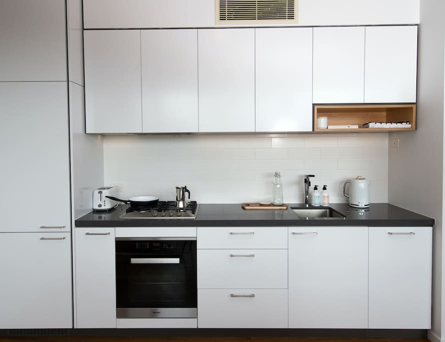 Kitchen facilities with complementary coffee for residents.