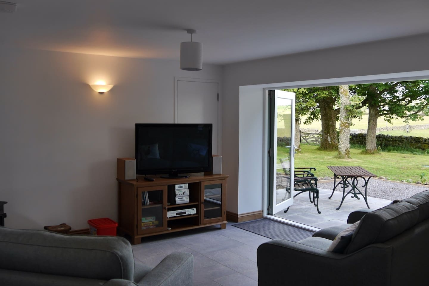 Living room with direct access to the patio and views over adjoining fields