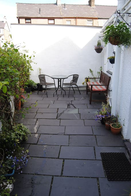 Front slate patio, great sun trap with bench & bistro set