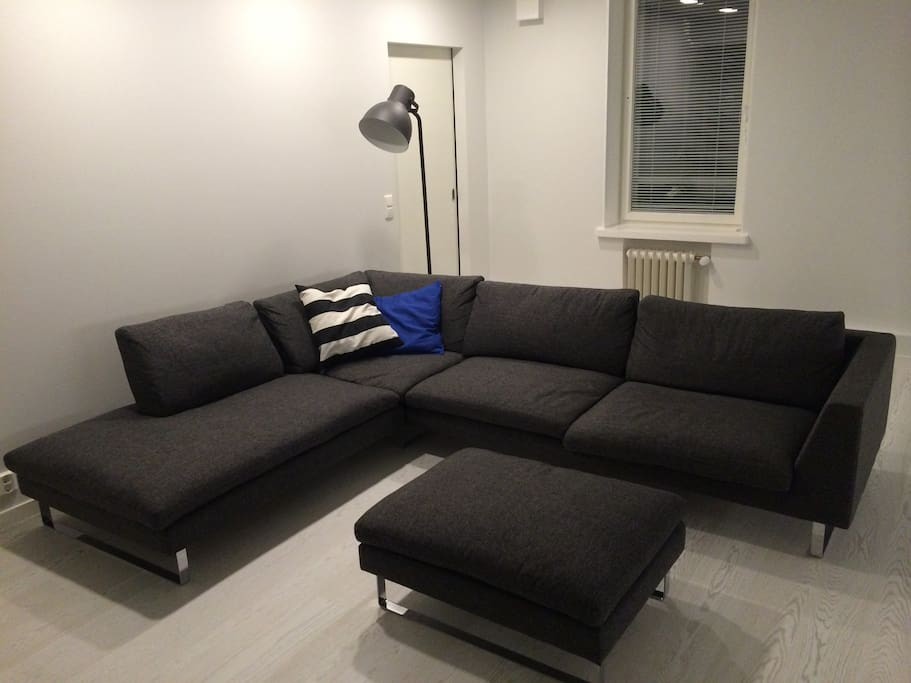 Comfortable sofa with footstool