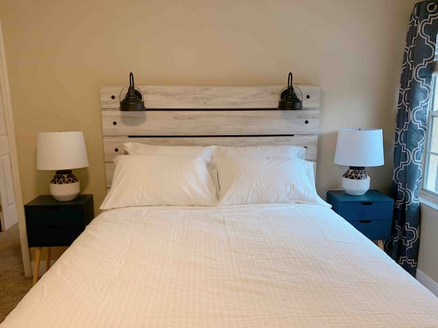 2nd bedroom with queen bed. High end hotel branded mattresses, 100% cotton sheets, and black out curtains will give you the greatest sleeping experience.