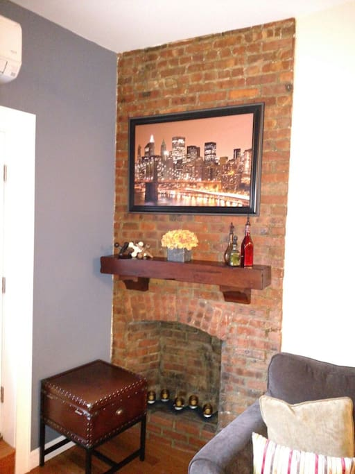 Exposed brick (non-working) Fireplace w/ Brooklyn charm