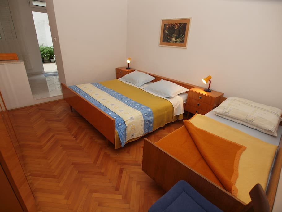 bedroom with double bed and one additional bed