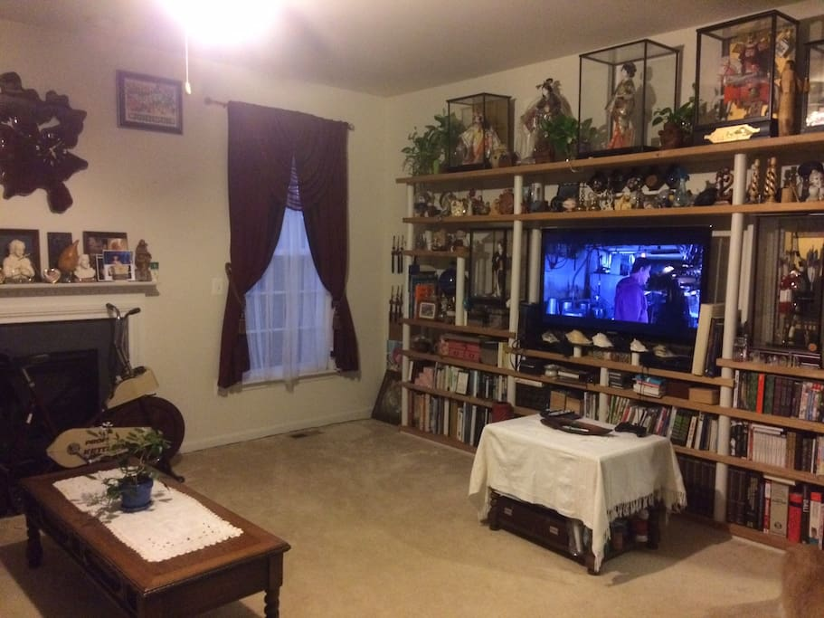 Family room with a big TV with a cable and movie stations
