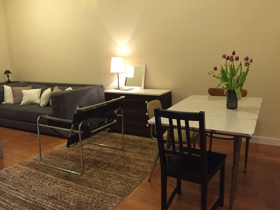 Dining area and Large couch with leather chair.