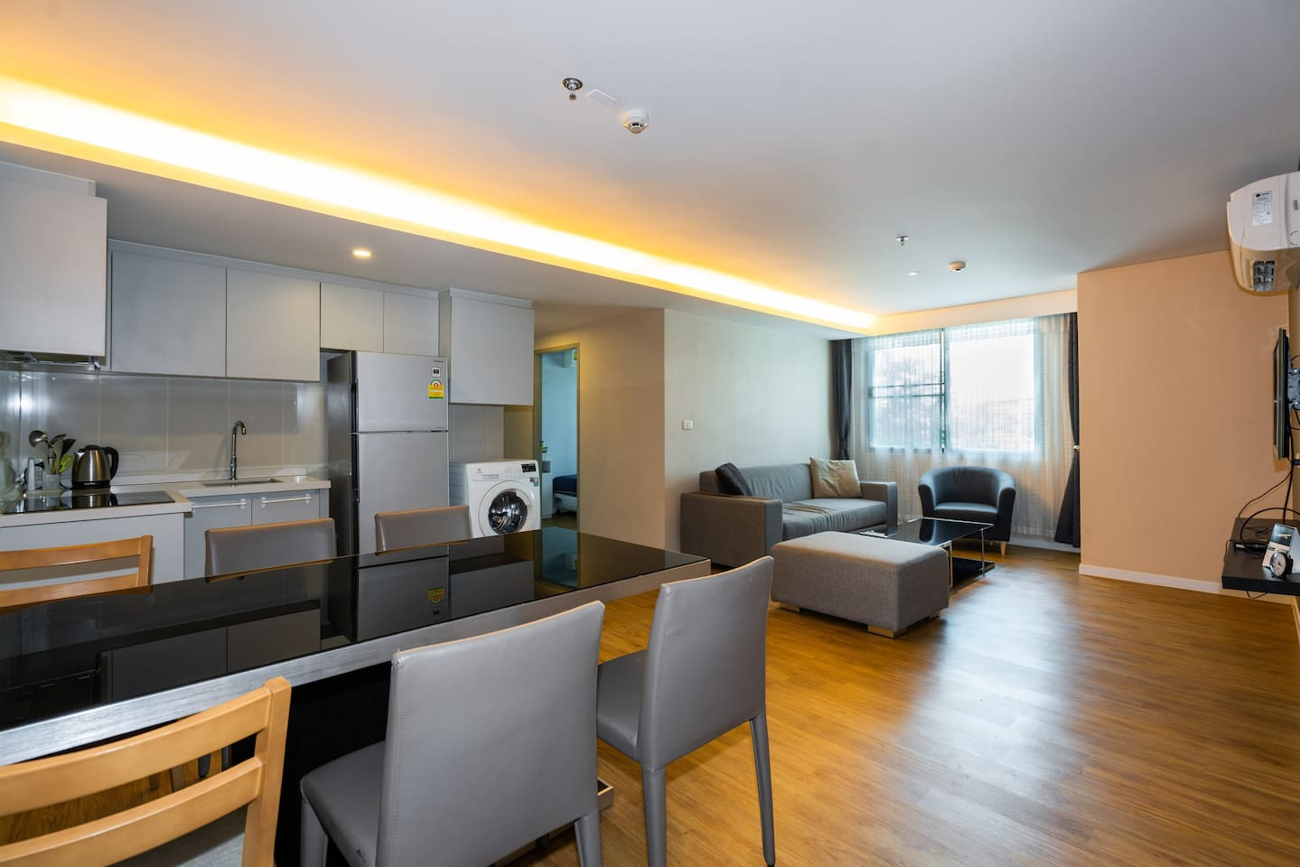 Spacious living room and full kitchen for cooking.