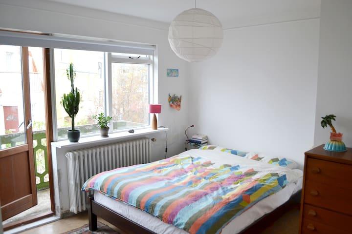 Master bedroom and balcony.