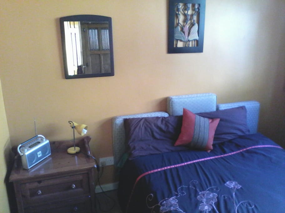 Your room, with double bed, wardrobe, digital radio and TV set.