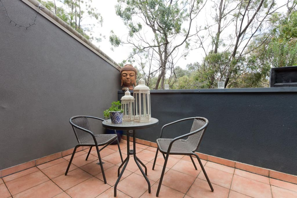 Downstairs creek-side balcony with large 6 seater extendable table and awesome BBQ!