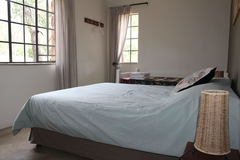 The grey bedroom can accommodate 3 guests in a double and a single bed